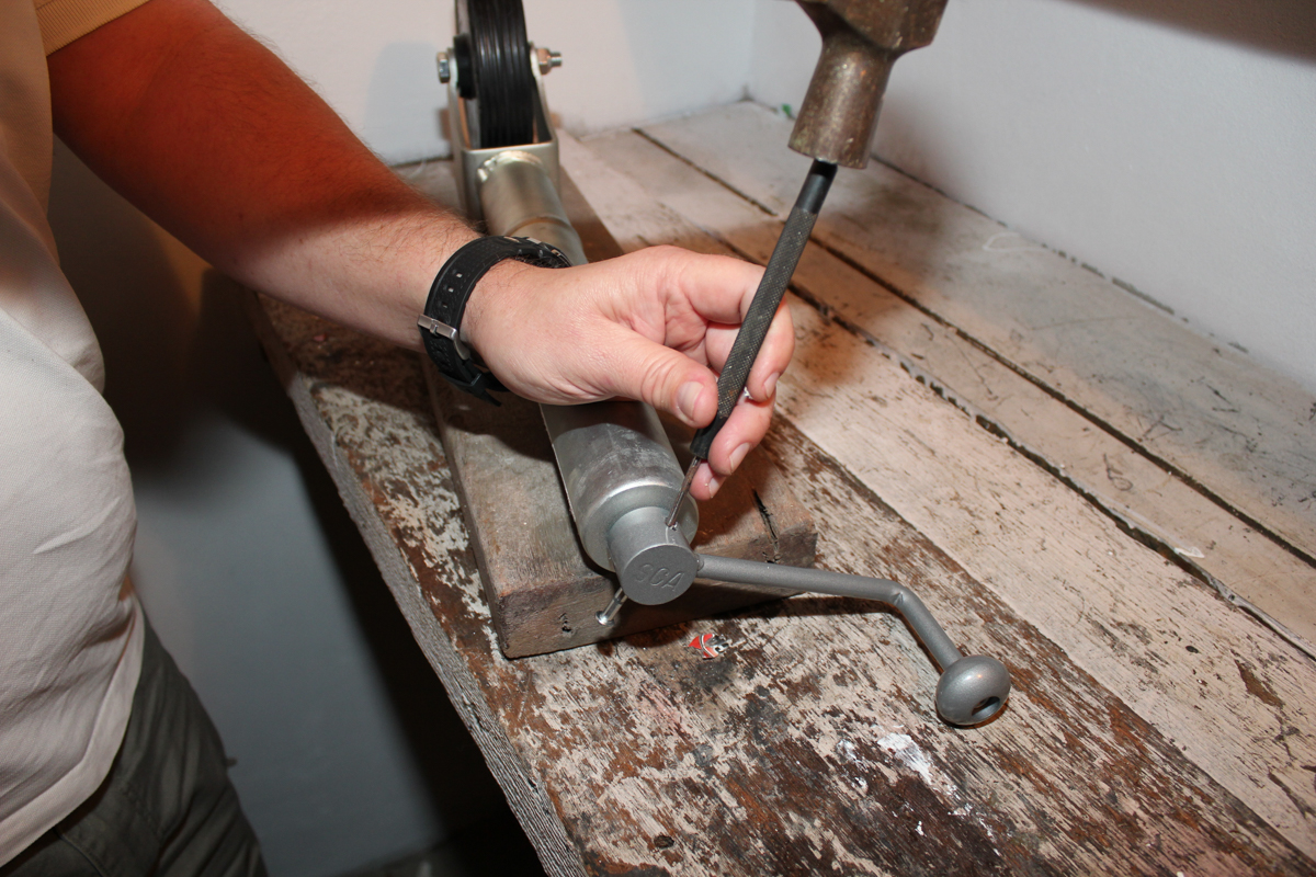 2 Use a hammer and punch to remove the remains of the pin